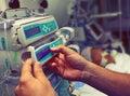 Medical worker configures equipment in ICU