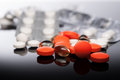 Medicaments colorful tablets or pills on reflect background Stock Photo
