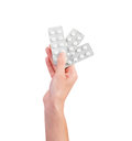 Medicaments human hand holding blisters of medications Royalty Free Stock Photos