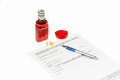 Medicare insurance application pen and a pill bottle with money coming out of the top on a white background Stock Photography