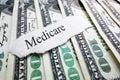 Medicare money newspaper headline on assorted Stock Images
