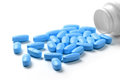 Medication bottle with blue pills isolated Royalty Free Stock Photo