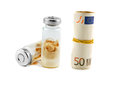 Medication pharmaceutics medical ampoules on money Stock Photography