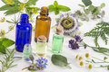 Medicinal plant and flower selection , peppermint, passiflora,, sage, thyme, lavender  lemon balm with an aromatherapy Royalty Free Stock Photo