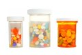 Medicine bottles isolated three pill filled with assorted medications on white Stock Photo