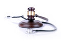 Medicine and law gavel stethoscope concept of Stock Photos