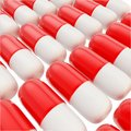 Medicine pill glossy red and white capsules background medical made of Stock Photo