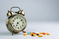 Medicine time variety of pills with clock for concept Stock Photo