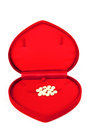 Medicines in heart shape luxury box Royalty Free Stock Image