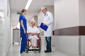 Medics and senior woman in wheelchair at hospital Royalty Free Stock Photo