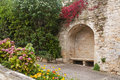Medieval alcove with stone bench in a wall Stock Images