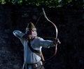 Arquero arco y dardos