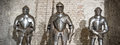 Medieval armor knight steel metal horizontal brick wall brown Royalty Free Stock Photo