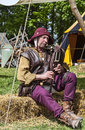 Medieval bagpiper nogent le rotrou france performing in front of traditional tents during the percheval festival near Stock Image