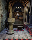 Medieval baptismal font in an old gothic church Stock Photo