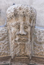 Medieval bas relief head statue in italy Royalty Free Stock Images