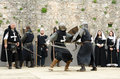 Medieval battle the actors acting in movie scene of knight fighting with swords and shields filming scene Stock Image