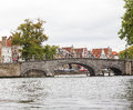 Medieval bridge over canal in Bruges Royalty Free Stock Image