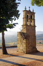 Medieval campanile christian built with granite with bronze bells Stock Photography