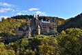 Medieval castle eltz located on the mountain in germany fortness sunny autumn day forest Royalty Free Stock Image