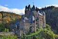 Medieval castle eltz located on the mountain in germany fortness sunny autumn day forest Royalty Free Stock Photos