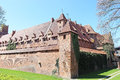 Medieval castle in malbork marienburg poland the of the teutonic order is the largest the world by surface area and the largest Stock Photo
