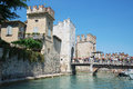 medieval castle Scaliger in old town of Sirmione . beautiful lake Lago di Garda, Italy. June 19, 2017 Royalty Free Stock Photo
