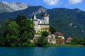 Medieval castle in an small island on Annecy lake france Savoy Saint Bernard Royalty Free Stock Photo