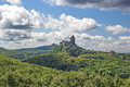 Medieval castles surrounded by green forests Royalty Free Stock Images