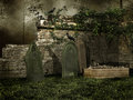 Medieval cemetery with bones old tombstones and a raven Royalty Free Stock Photography