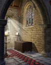 Medieval church aisle with candles and wooden trunk Royalty Free Stock Photography