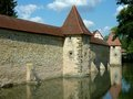 Medieval city wall with towers and water Royalty Free Stock Photography