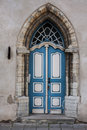 Medieval door blue arched wooden Stock Photography