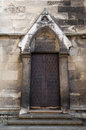 Medieval door detail of a church side Royalty Free Stock Photo