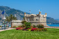 Medieval fortress in menton france green grass with flowers on promenade and Royalty Free Stock Photography
