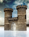 Medieval gate with closed lattice and guard towers Stock Images