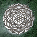 Medieval handicraft metal flower china in green stone small detail of chinese palace floor Stock Images
