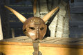 Medieval helmet with horns metal on wooden chest Stock Photography
