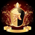 Medieval heraldic shield ornate golden ornament and crown Royalty Free Stock Photography