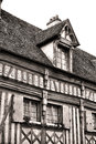 Medieval house with half timber facade in france fifteenth century detail outside exposed wood beam timbers wall and wood shingle Stock Photo