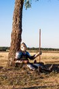 Medieval knight in the field with an axe Stock Photos