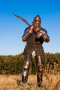 Medieval knight in the field with an axe Stock Images