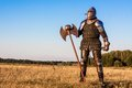 Medieval knight in the field with an axe Royalty Free Stock Photography
