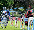 Medieval knight s on horseback view of competing in a jousting tournament Stock Image