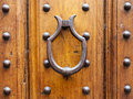 Medieval knocker on old door in Florence city Royalty Free Stock Photo