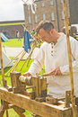 Medieval lathe in operation. Royalty Free Stock Image