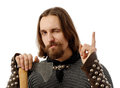 Medieval man with axe and with his finger up Royalty Free Stock Photography