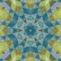 Medieval mosaic star or flower in gold, green and blue teal effect glass Royalty Free Stock Photo
