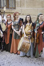 Medieval musicians group detail of a of beautiful women who play ancient music Stock Image