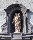 Medieval niche with the holy virgin in the beguinage of bruges brugge belgium stone christ flanders Royalty Free Stock Photos